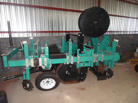 Ridger and plastic mulch machine